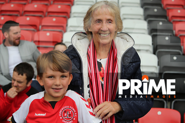 Fleetwood Town Mascots poses for a picture with his grandma ahead of the Sky Bet League 1 match between Fleetwood Town and Rochdale at Highbury Stadium, Fleetwood, England on 18 August 2018. Photo by Stephen Gaunt / PRiME Media Images.