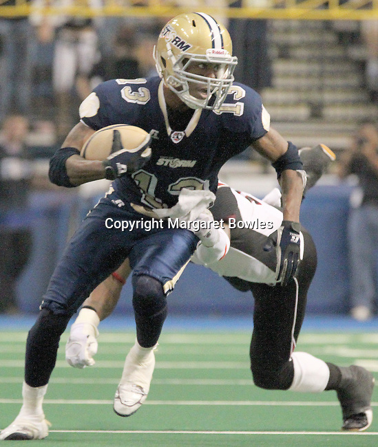 05 June 2010: Tampa Bay wide receiver DeAndrew Rubin gets a first down on a pass reception as Oklahoma City defensive back Sergio Gilliam defends. The Tampa Bay Storm defeated the Oklahoma City Yard Dawgz 50-48 at the St. Pete Forum in Tampa, Florida