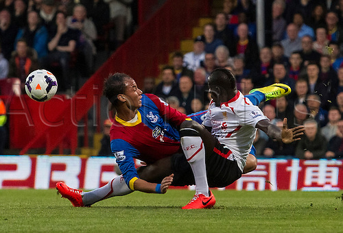 05.05.2014  London, England. Crystal Palace forward Marouane Chamakh (29) and Liverpool defender Mamadou Sakho (17) in a crunching tackle during the Barclays Premier League match between Crystal Palace and Liverpool from Selhurst Park