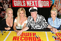 "27 September 2017 - Hugh Marston Hefner aka ""Hef"" was an American magazine publisher, editor, businessman, and international playboy best known as the editor-in-chief and publisher of Playboy magazine, which he founded in 1953. Hefner was the founder and chief creative officer of Playboy Enterprises, the publishing group that operates the magazine. Hefner was also a political activist and philanthropist. File Photo: 3 August 2006 - West Hollywood, California. Kendra Wilkinson, Bridget Marquardt, Hugh Hefner and Holly Madison. ""The Girls Next Door"" DVD and Magazine Signing at Tower Records. Photo Credit: Byron Purvis/AdMedia"