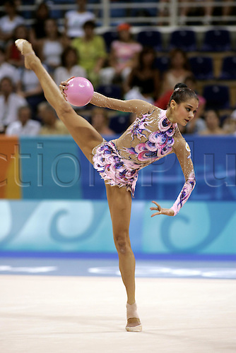 26 August 2004: Russian gymnast IRINA TCHACHINA (RUS) performs with ball during the Rhythmic Gymnastics Individual All Round Qualification in the Galatsi Olympic Hall. TCHACHINA won silver in the Individual All Round Final. 2004 Olympic Games, Athens, Greece. Photo: Neil Tingle/Action Plus...040826 woman women poise performing routine