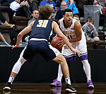 SIOUX FALLS, SD - MARCH 10:   Talon Pinckney #11 from the College of Idaho looks for a teammate while being guarded by Christian Stewart #30 from Marian during their quarterfinal game at the 2018 NAIA DII Men's Basketball Championship at the Sanford Pentagon in Sioux Falls. (Photo by Dave Eggen/Inertia)