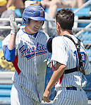 Reno's Hayes Riedeman, left, gets a high five after scoring in the NIAA Division I Northern Region Baseball Championship between the Galena Grizzlies and the Reno Huskies played on Saturday, May 14, 2016 at Peccole Park in Reno, Nevada.