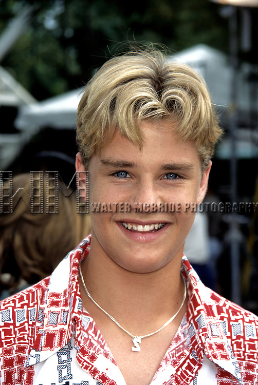 Zachary Ty Bryant photographed at Walt Disney World's 25th Anniversary. Fall 1996. © Walter McBride / .