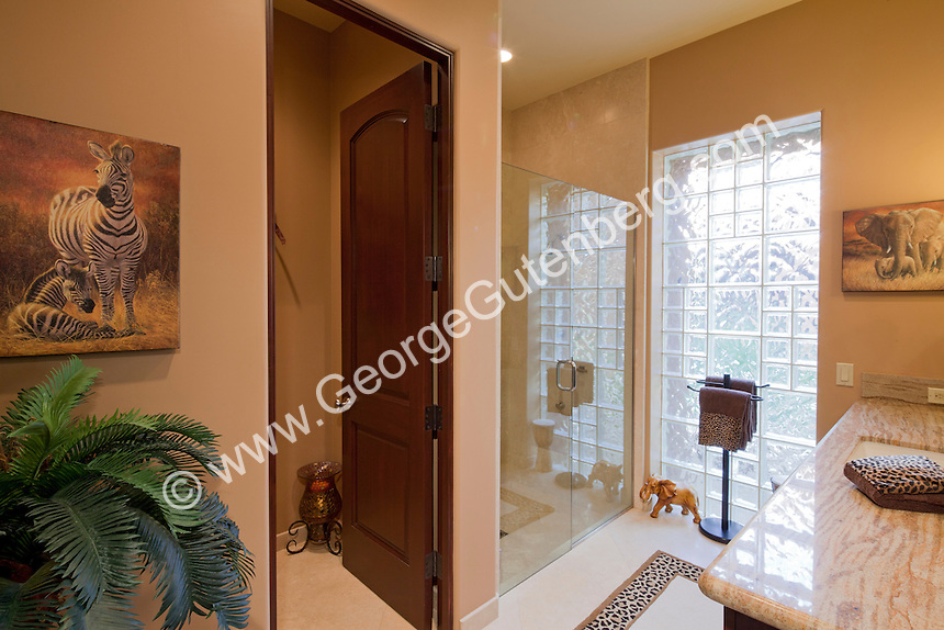 Glass shower cabinet is shown with glass block wall Stock photo of master bath, en suite, bathroom