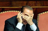 Silvio Berlusconi parla al telefono con una mano sul volto<br /> Roma 02-10-2013 Senato. Discorso programmatico del Presidente del Consiglio a cui segue un voto di fiducia per risolvere la crisi di governo.<br /> Speech of the italian premier at the senate and voctation to solve the crisis of the government.<br /> Photo Samantha Zucchi Insidefoto