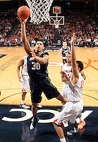 Notre Dame forward Zach Auguste (30) shoots next to Virginia forward Anthony Gill (13)  during the game Saturday, February 22, 2014,  in Charlottesville, VA. Virginia won 70-49.