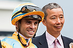 Jockey Umberto Rispoli, who rode #8 Full of Chances, (L) and trainer Benno Yung Tin-pang (R) pose for photo after winning the race 2 during Hong Kong Racing at Sha Tin Racecourse on October 01, 2018 in Hong Kong, Hong Kong. Photo by Yu Chun Christopher Wong / Power Sport Images