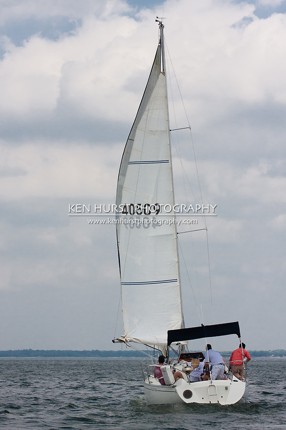 A Beneteau First 29 sailboat racing at the Chaos Cup, Lakefest Regatta at Lake Texoma, April 2011.