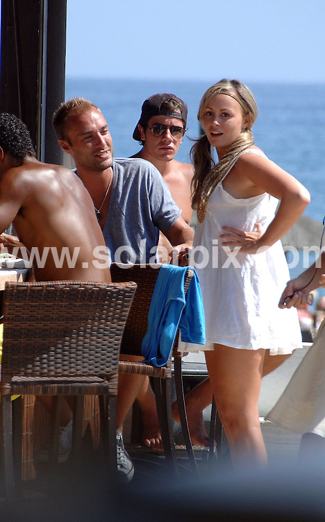 **ALL ROUND EXCLUSIVE PICTURES FROM SOLARPIX.COM**.**WORLDWIDE SYNDICATION RIGHTS**.Ex Big Brother Chanelle Hayes joined her friends Footballer Jermaine Pennant  & playboy Cullum Best for lunch a trendy Budhha Beach Club in Marbella ..Chanelle looked after the boys by putting sun cream on Jemaine and giving Cullum an eye full of her boobs..Chanelle has been in Marbella for the bank holiday recovering from her depression but by the looks of her she is doing just fine...This pic:Chanelle Hayes & Cullum Best..JOB REF:  9834        JGS        DATE:31.08.09.**MUST CREDIT SOLARPIX.COM OR DOUBLE FEE WILL BE CHARGED**.**MUST AGREE FEE BEFORE ONLINE USAGE**.**CALL US ON: +34 952 811 768 or LOW RATE FROM UK 0844 617 7637**