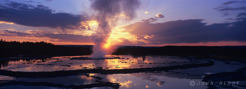 Panorama of colorful sunset at Great Fountain Geyser at Firelole Lake area of Yellowstone National Park, Wyoming