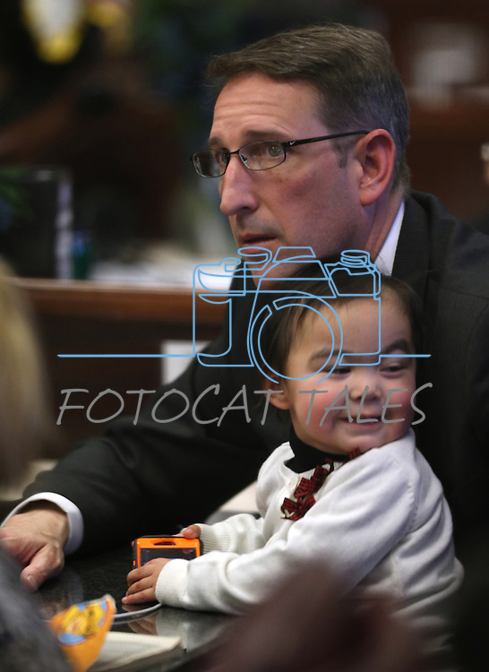 Nevada Sen. Scott Hammond, R-Las Vegas, sits with his daughter Isabella during the opening day of the 77th Legislative Session in Carson City, Nev. on Monday, Feb. 4, 2013..Photo by Cathleen Allison