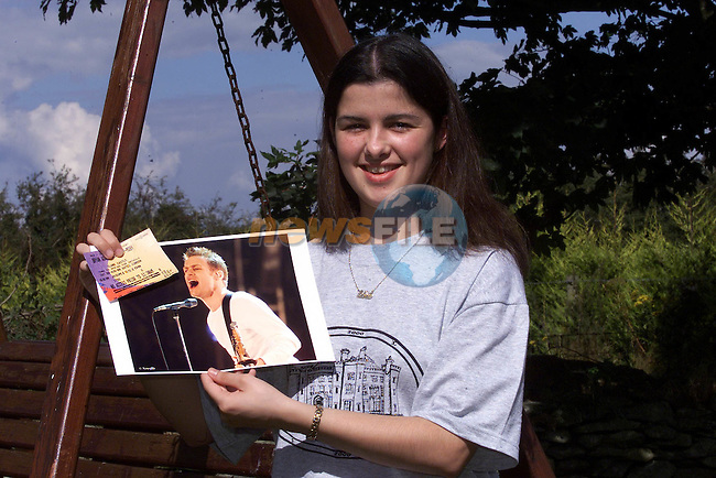 Lisa McEvoy from Monasterboics with her ticket from Slance Concert and A picture of Brian Adams. Lisa was brought up on stage by Brian Adams to sing with him and Mel C during the Concert on Saturday night..Pic Fran Caffrey Newsfile