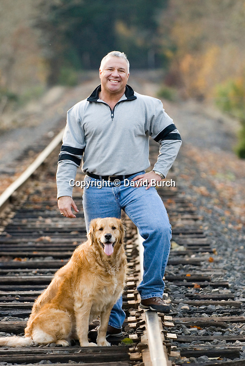 Man standing with his dog