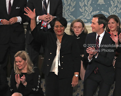 Alice Johnson who had been serving a mandatory life sentence without parole for charges associated with a nonviolent drug case waves to the audience as she is introduced by United States President Donald J. Trump during his second annual State of the Union Address to a joint session of the US Congress in the US Capitol in Washington, DC on Tuesday, February 5, 2019.  Johnson, who's case was brought to the President's attention by actress Kim Kardashian and Senior Advisor Jared Kushner, right, was granted clemency on June 6, 2018. <br /> Credit: Alex Edelman / CNP