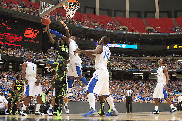 UK forward Terrence Jones contests a shot by Baylor Bears forward Quincy Miller. Kentucky faced Baylor during the 2012 NCAA Tournament Regional Finals at the Georgia Dome in Atlanta, March 25, 2012. Photo by Derek Poore