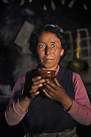 Tibat, Central<br /> Lunang Valley, Tibetan woman drinking tea at home, 2004