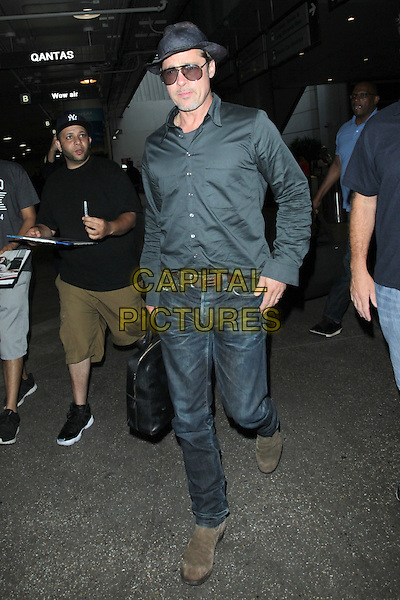 LOS ANGELES, CA - JUNE 21: Brad Pitt seen at LAX airport in Los Angeles, California on June 21, 2016. <br /> CAP/MPI99<br /> &copy;MPI99/Capital Pictures