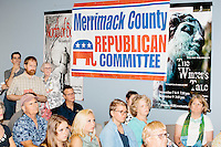 People listen as former Pennsylvania senator and Republican presidential candidate Rick Santorum speaks at a town hall event at the Concord office of New England College in Concord, New Hampshire.