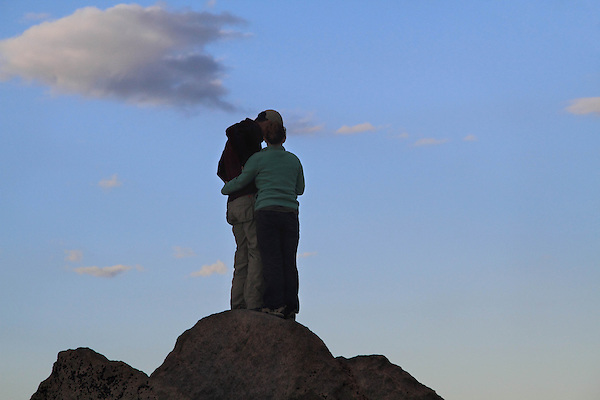 Couple on the summit of Mount Evans in the Mt Evans Wilderness Area, west of Denver, Colorado.