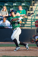 Leonardo Rojas (11) of the Augusta GreenJackets follows through on his swing against the Hickory Crawdads at L.P. Frans Stadium on May 11, 2014 in Hickory, North Carolina.  The GreenJackets defeated the Crawdads 9-4.  (Brian Westerholt/Four Seam Images)