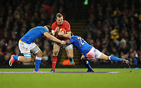 Wales Hadleigh Parkes is tackled by Italy&rsquo;s Giovanni Licata and Jayden Hayward<br /> <br /> Photographer Ian Cook/CameraSport<br /> <br /> 2018 NatWest Six Nations Championship - Wales v Italy - Sunday 11th March 2018 - Principality Stadium - Cardiff<br /> <br /> World Copyright &copy; 2018 CameraSport. All rights reserved. 43 Linden Ave. Countesthorpe. Leicester. England. LE8 5PG - Tel: +44 (0) 116 277 4147 - admin@camerasport.com - www.camerasport.com
