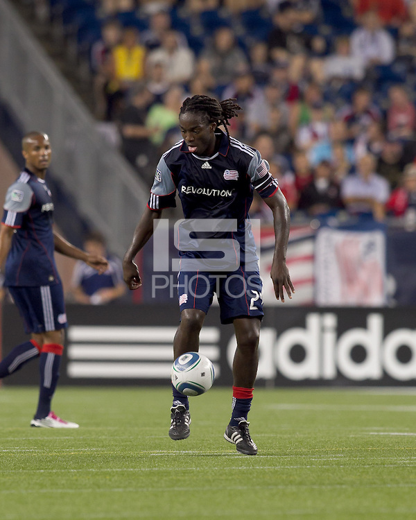 New England Revolution midfielder Shalrie Joseph (21) traps the ball. The New England Revolution tied Columbus Crew, 2-2, at Gillette Stadium on September 25, 2010.