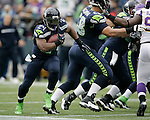 Seattle Seahawks running back Marshawn Lynch rushes for eight his of his 124 yards against Minnesota Vikings at CenturyLink Field in Seattle, Washington on  November 4, 2012.  Lynch rushed for 124 yards and scored one touchdown in the Seahawks 30-20 win over the Vikings.