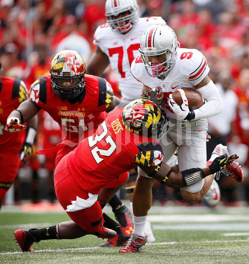 Ohio State Buckeyes wide receiver Devin Smith (9) gets tackled by Maryland Terrapins defensive back Jarrett Ross (32) after making a catch during the second quarter of the NCAA football game at Byrd Stadium in College Park, Maryland on Oct. 4, 2014. (Adam Cairns / The Columbus Dispatch)