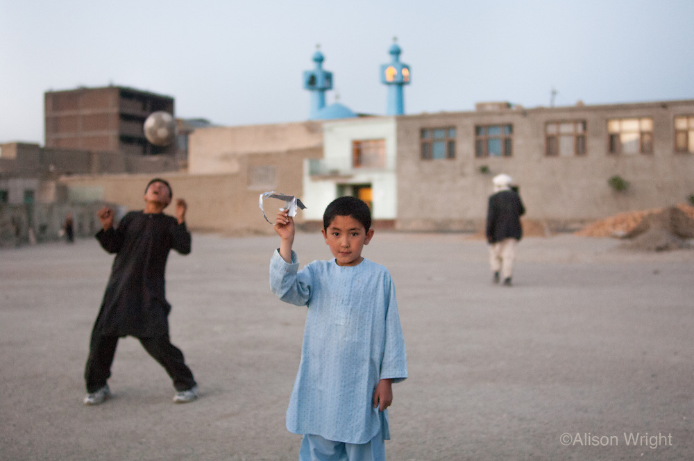 Boys playing in front of mosque.