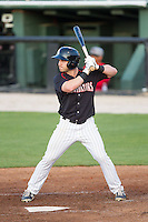 Kale Kiser (9) of the Kannapolis Intimidators at bat against the Hickory Crawdads at CMC-Northeast Stadium on May 19, 2014 in Kannapolis, North Carolina.  The Crawdads defeated the Intimidators 10-6.  (Brian Westerholt/Four Seam Images)