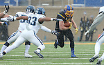 BROOKINGS, SD - DECEMBER 3:  Kyle Paris #32 from South Dakota State looks to gain yardage past Jafonta Johnson #50 and Ed Shockley #33 from Villanova during their second round playoff game Saturday afternoon at Dana J. Dykhouse Stadium in Brookings, SD. (Photo by Dave Eggen/Inertia)