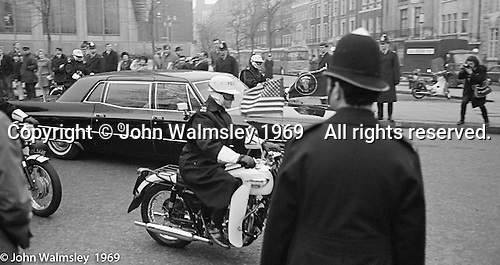 Motorcade takes US President Richard M Nixon away from the US Embassy in Grosvenor Square, London.  27th February 1969.
