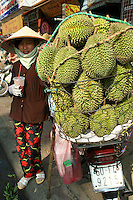 "Durian Vendor, Ben Thanh Market - Widely known and appreciated in southeast Asia as the ""king of fruits the durian is distinctive for its large size, unique odour and formidable thorn covered husk.  The edible flesh emits a distinctive smell, strong and penetrating even when the husk is intact. Some people regard the durian as fragrant; others find the aroma overpowering and offensive - the smell evokes reactions from deep appreciation to intense disgust. The odour has led to the fruit's banishment from hotels and public transportation in southeast Asia."