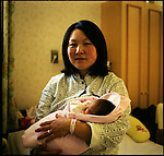 "Mrs. Mariko Kurumatsuka, 31, holds her newborn daughter, Haru, in one month after the earthquake at Abeno Clinic in Ishinomaki, Miyagi. ""Are you OK?"", Mrs. Kurumatsuka who was pregnant with 8 months baby, sent a short message to her husband's mobile phone right after the huge earthquake. ""Yes, I'm OK"", after she received the message from her husband, the phone line was cut off. Tsunami attacked Higashimatsushima where her husband worked. Her husband saw tsunami on the rearview mirror of his car. He flattened the gas pedals to go up the hill. Two days after the earthquake, they reached their house and found each other alive. On the 7th of April, another earthquake of magnitude 7.0 hit their area. They lost electricity and water again. At night her labor started. They tried to call a hospital, but the line was cut off again. Without knowing if the hospital is open or not, they drove to the hospital. The hospital was open. Their daughter, Haru, ""spring"" in Japanese, was born next day on the 8th of April. ""One day, we will tell her the story of this earthquake and tsunami,"" she said. ""We will not be able to forget about it forever.""<br />