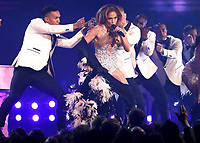 Jennifer Lopez changes outfits during a tribute to Motown's 60th anniversary at the 61st annual Grammy Awards on Sunday, Feb. 10, 2019, in Los Angeles. (Photo by Matt Sayles/Invision/AP)
