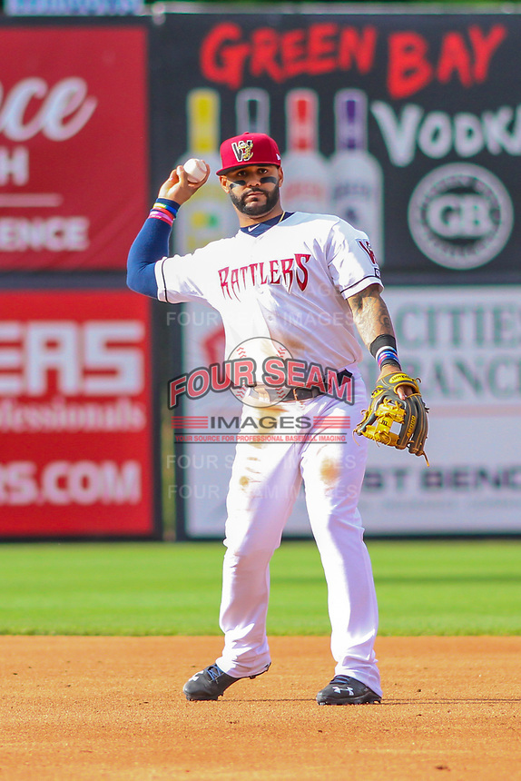 Milwaukee Brewers second baseman Jonathan Villar (3) throws to first base during a rehab appearance with the Wisconsin Timber Rattlers in game one of a Midwest League doubleheader against the Kane County Cougars on June 23, 2017 at Fox Cities Stadium in Appleton, Wisconsin.  Kane County defeated Wisconsin 4-3. (Brad Krause/Four Seam Images)