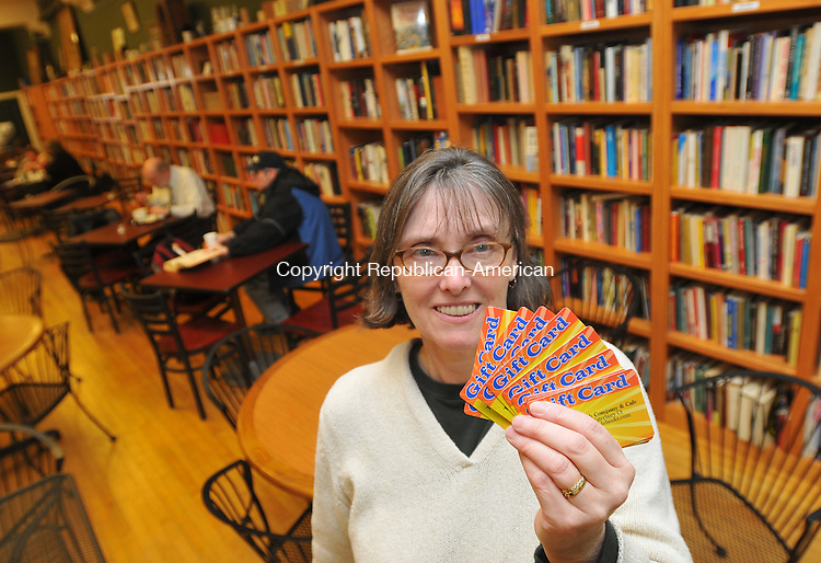 WATERBURY, CT- 10 December 2009 - 121009IP01- Ede Reynolds (cq), owner of The John Bale Book Company &amp; Cafe in Waterbury is offering  gift cards for sale at the store.<br /> Irena Pastorello Republican-American