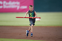 A young fan runs towards first base with a giant toothbrush between innings of the South Atlantic League game between the Hagerstown Suns and the Kannapolis Intimidators at Kannapolis Intimidators Stadium on August 27, 2019 in Kannapolis, North Carolina. The Intimidators defeated the Suns 5-4. (Brian Westerholt/Four Seam Images)