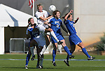 04 November 2009: Florida State's Lauren Switzer (8) and Duke's Kendall Bradley (12) challenge for a header. The Florida State University Seminoles defeated the Duke University Blue Devils 2-0 at Koka Booth Stadium in WakeMed Soccer Park in Cary, North Carolina in an Atlantic Coast Conference Women's Soccer Tournament Quarterfinal game.