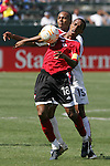 9 June 2007: Trinidad and Tobago's Densill Theobald (18) screens United States midfielder Ricardo Clark (19) away from the ball. The United States Men's National Team defeated the National Team of Trinidad & Tobago 2-0 at the Home Depot Center in Carson, California in a first round game in the CONCACAF Gold Cup.