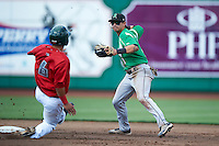 Dayton Dragons shortstop Juan Perez #11 turns a double play as Jace Peterson #6 slides in during a Midwest League game against the Fort Wayne TinCaps at Parkview Field on August 19, 2012 in Fort Wayne, Indiana.  Dayton defeated Fort Wayne 5-1.  (Mike Janes/Four Seam Images)