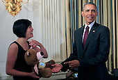 """Hannah Chung of Providence, Rhode Island shows United States President Barack Obama the Sproutel company invention Jerry the Bear as the President views White House Demo Day exhibits on the state floor of the White House in Washington, DC on August 4, 2015.  Jerry the bear is a smart stuffed animal with educational apps that help kids build healthy behaviors centered on nutrition, exercise, sleep, and mindfulness. Additional modules customize Jerry to provide specific education for chronic illnesses like type 1 diabetes. Jerry is built by Sproutel, a company founded by Hannah Chung and Aaron Horowitz. In his youth, Aaron was diagnosed with human growth hormone deficiency, a condition that also requires self-administered injections, and several members of Hannahís family have Type 2 diabetes. Hannah was previously named as one of Inc. Magazine's """"15 Women to Watch in Tech,"""" and co-founded of Design for America.<br /> Credit: Dennis Brack / Pool via CNP"""