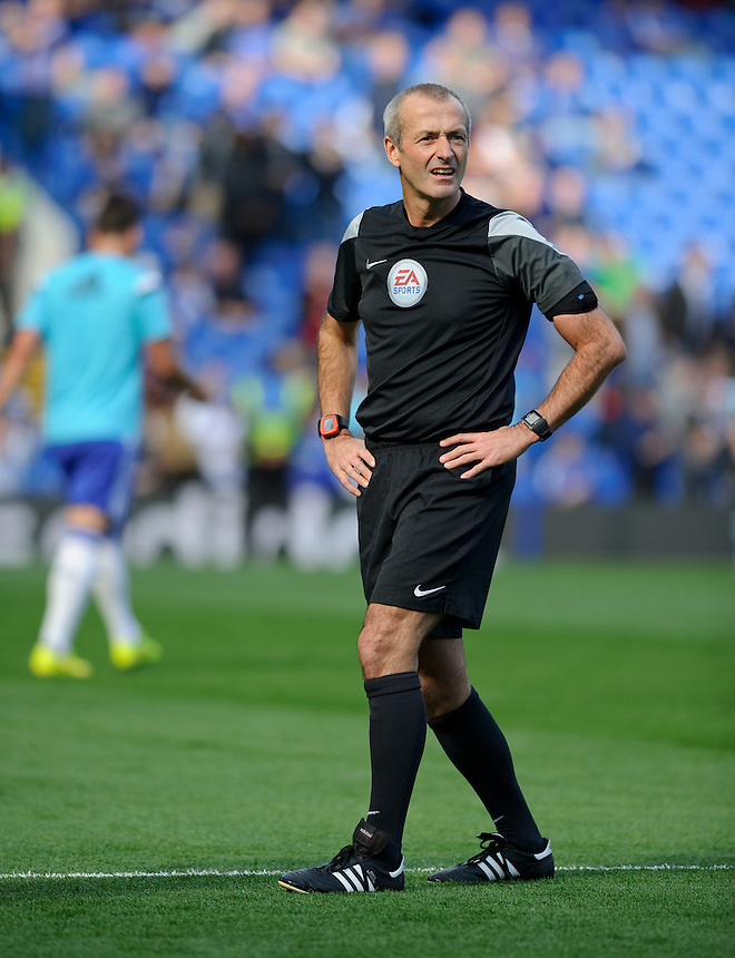 Referee Martin Atkinson<br /> <br /> Photographer Ashley Western/CameraSport<br /> <br /> Football - Barclays Premiership - Chelsea v Arsenal - Sunday 05th October 2014 - Stamford Bridge - London<br /> <br /> &copy; CameraSport - 43 Linden Ave. Countesthorpe. Leicester. England. LE8 5PG - Tel: +44 (0) 116 277 4147 - admin@camerasport.com - www.camerasport.com