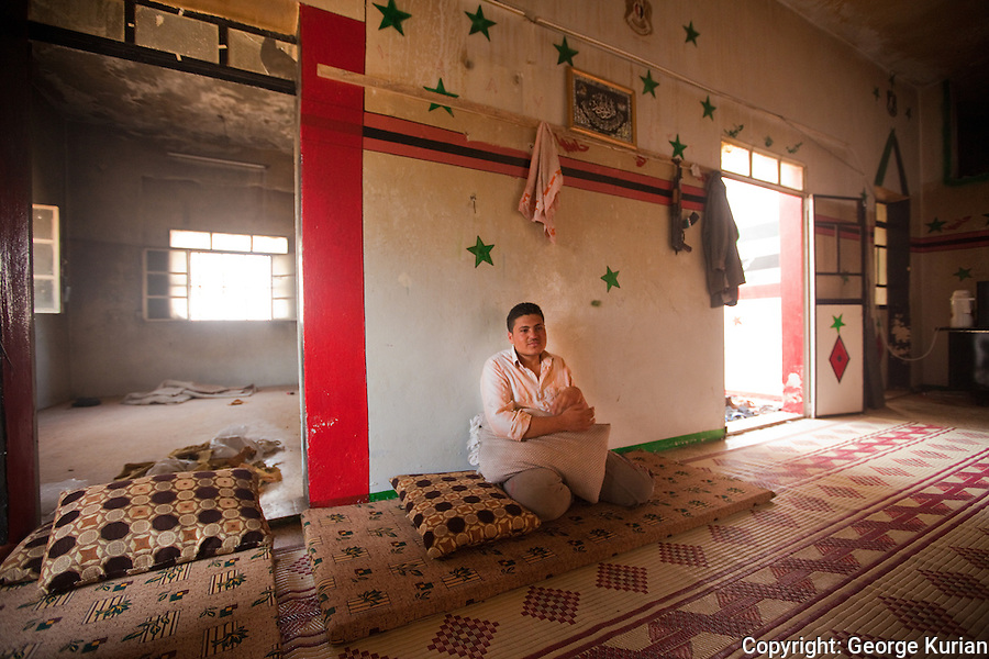 FSA Barracks in Marea. Abu Abdul, 20, a history student and Amin l8, who just finished high school, are the only guards at the barracks, while all the other fighters are in Aleppo.