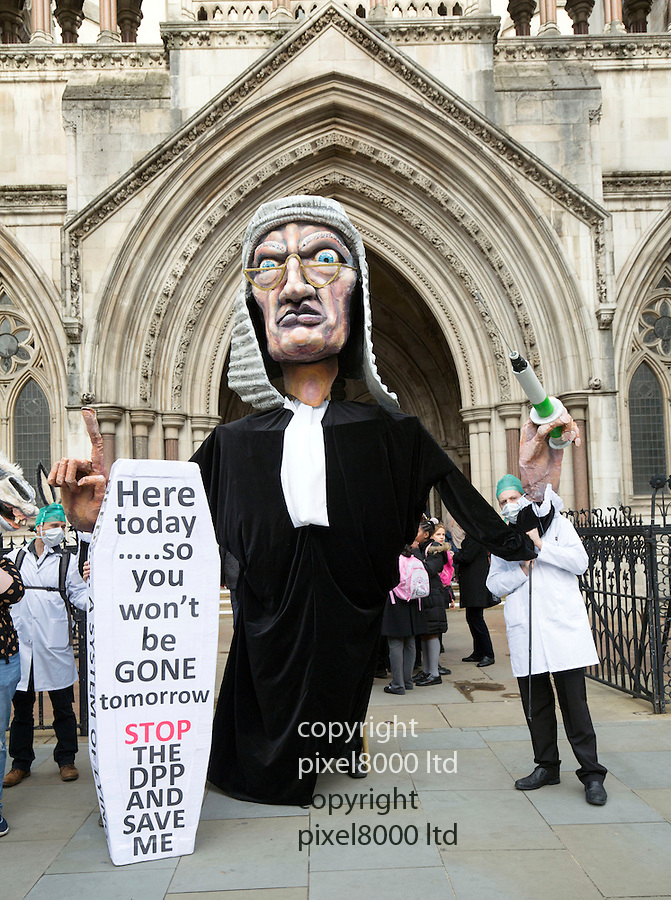 Pic shows:  Disability rights campaigners outside the Royal Courts of Justice in London today<br /> <br /> They paraded giant puppets of a high court judge and DPP Alison Saunders on an ass .<br /> <br /> <br />  Disability rights campaigners went to the High Court in England to challenge the prosecution policy in relation to the law on assisted suicide.<br /> Three judges in London will today hear the case brought against Director of Public Prosecutions (DPP) Alison Saunders.<br /> The UK's Suicide Act 1961 makes it a criminal offence to assist or encourage suicide. The DPP has discretion on whether to prosecute according to the published policy.<br /> Pic by Gavin Rodgers/Pixel 8000 Ltd 16.11.15<br /> <br /> <br /> <br /> <br /> Pic by Gavin Rodgers/Pixel 8000 Ltd