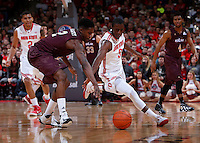 Louisiana-Monroe Warhawks forward DeMondre Harvey (2) and Ohio State Buckeyes guard Shannon Scott (3) chase a loose ball during Friday's NCAA Division I basketball game at Value City Arena in Columbus on December 27, 2013. Ohio State won the game 71-31. (Barbara J. Perenic/The Columbus Dispatch)