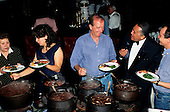 Sao Paulo, Brazil. Guests serving themselves from a feijoada buffet; the Maitre d'Hotel is assisting. Hilton Hotel.