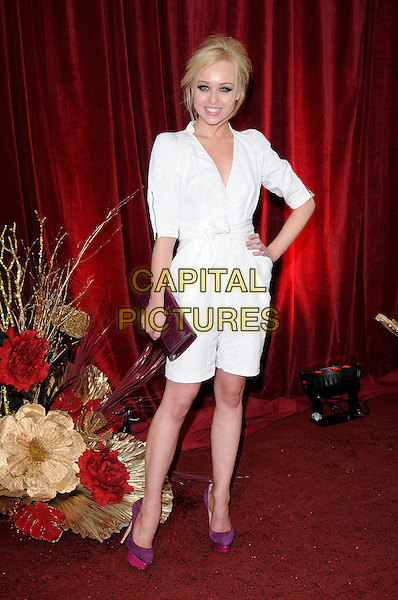 JORGIE PORTER .Attending The British Soap Awards 2010, The London Television Centre, London, England, UK, 8th May 2010 .arrivals full length white puff sleeve dress wrap belt waist purple shoes platform shirt hand on hip  pink .CAP/CAN.©Can Nguyen/Capital Pictures.