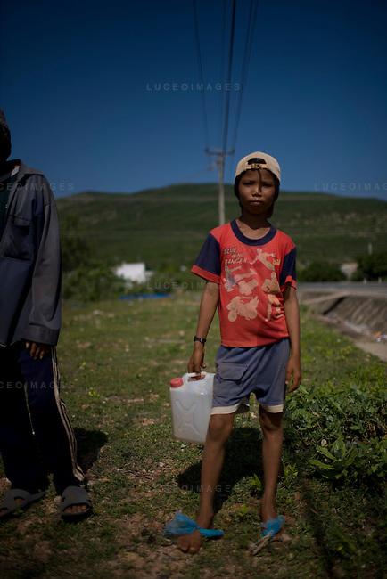 Cow farmer's son in Mui Ne.
